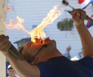 Paul Isaak eating Fire During a State Fair Show